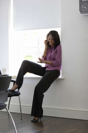 toils: Businesswoman using mobile phone