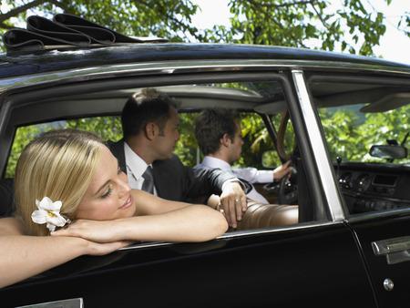 honeymooner: Wedding couple in car
