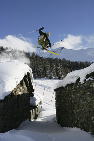 jeopardizing: Skier jumping over buildings
