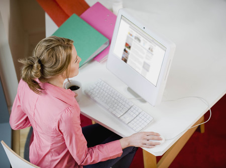 teleworking: Female working at her desk