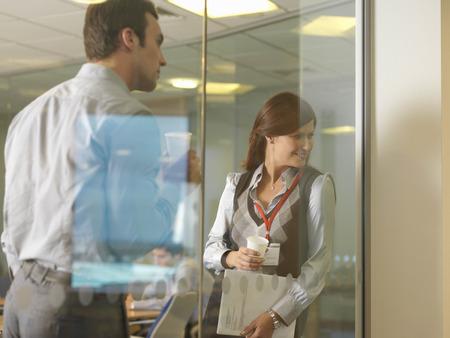 Office staff looking through window
