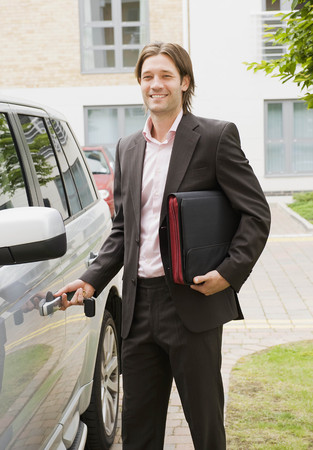 middlesex: Business man getting into car