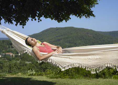 musically: Girl asleep in hammock