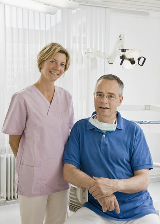 prideful: Portrait of a male dentist and assistant