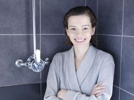 bathed: Woman in bathrobe standing in shower