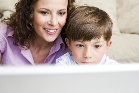 Computer instruction: Woman and son staring at laptop