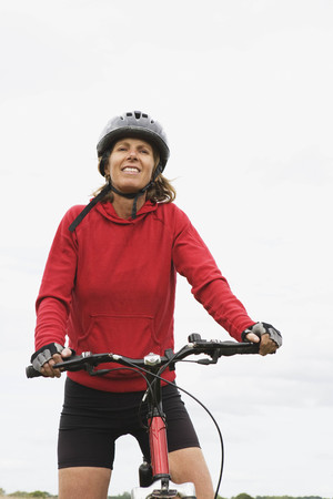 verticals: Woman cyclist on bicycle