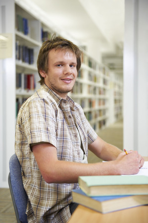 motivations: Portrait of young man in library