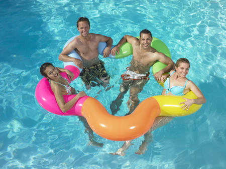 rejuvenated: Group of friends in pool