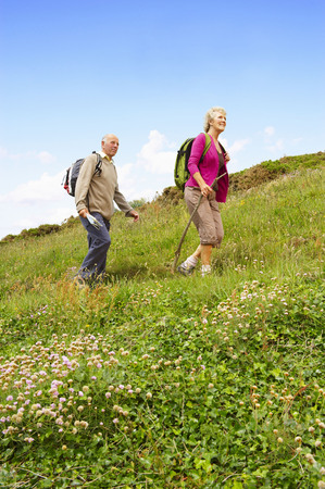 remoteness: Senior couple hiking
