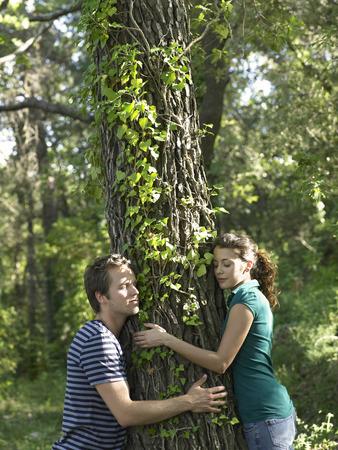 accountable: Couple hugging tree