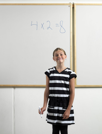 adverse: Girl standing by whiteboard