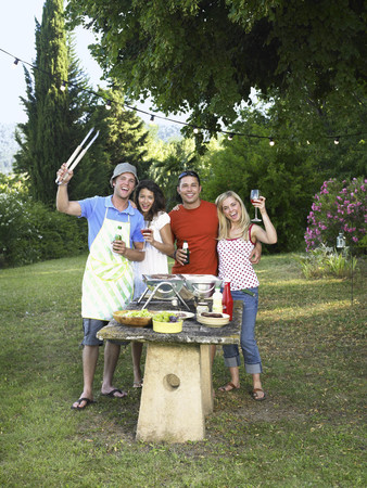 picnicking: Friends celebrating at barbecue