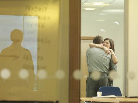 cuddled: Office couple cuddling