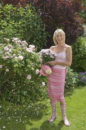 tetbury: Woman standing in rose garden