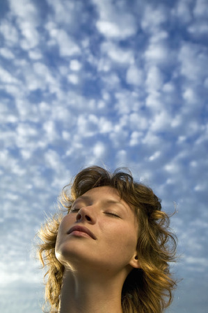 spiritual beings: Woman and clouds in a blue sky