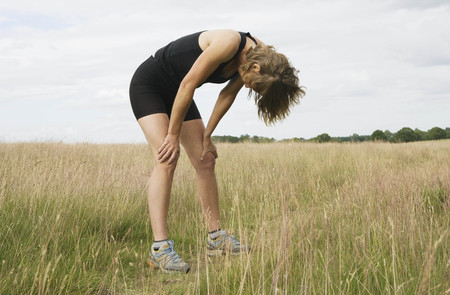 ceased: Exhausted woman runner resting