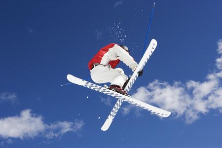 Skier performing jumping trick