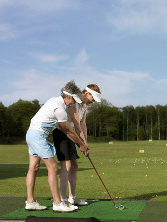 uncomplicated: Two women at driving range