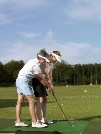 the elderly tutor: Two women at driving range
