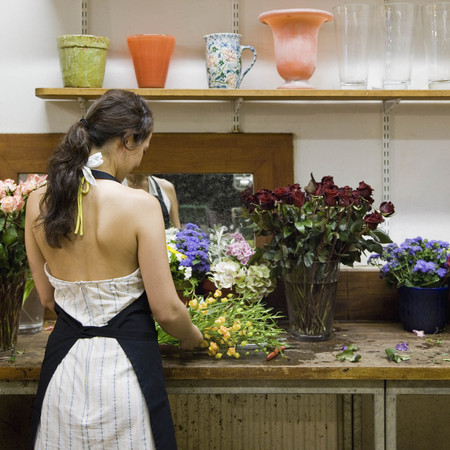 made in germany: Female clerk in a flower shop