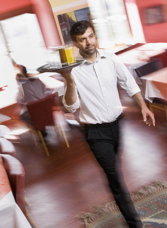 distributing: Male waiter with drinks in hand