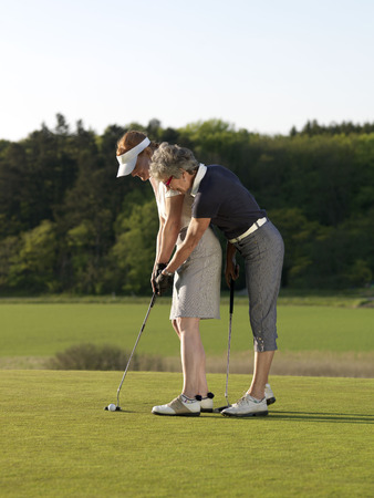 seventy: Two women on golf green