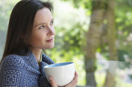 whimsy: Woman with a cup, looking outside