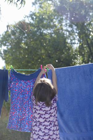 accountable: Young girl hanging washing LANG_EVOIMAGES