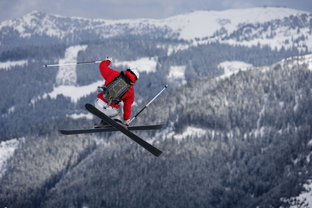 feats: Skier jumping trees in the background