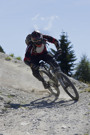 jeopardizing: Downhill mountain biker riding fast LANG_EVOIMAGES