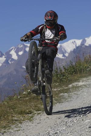 Mountain biker pulling a wheelie