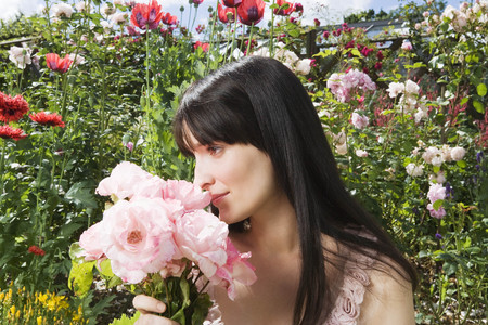 whimsy: Woman smelling roses in garden