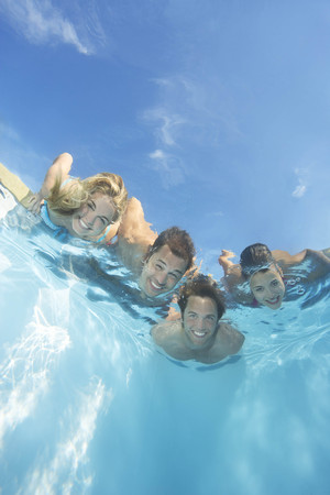 sweethearts: Group of friends submerged in pool