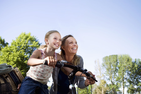 2 50: Mother and daughter with bike
