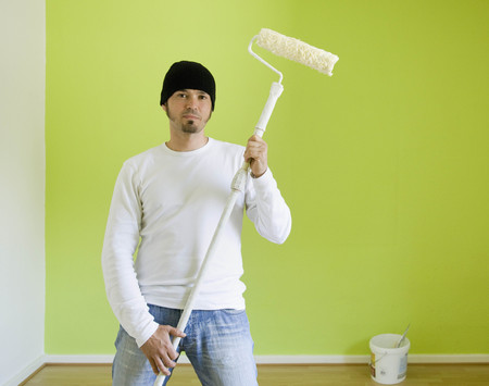 prideful: Portrait of a man painting a room
