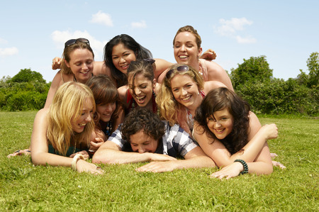 Portrait of a group young people on lawn LANG_EVOIMAGES