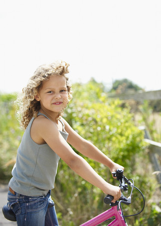 Young girl riding bicycle