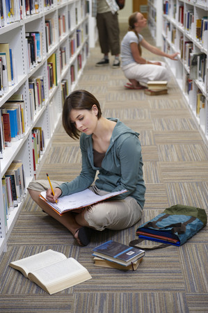somber: Young students in a library
