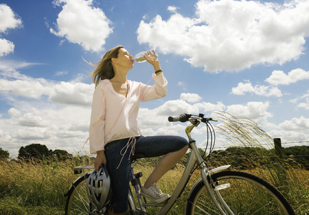 ceased: Female cyclist drinking water