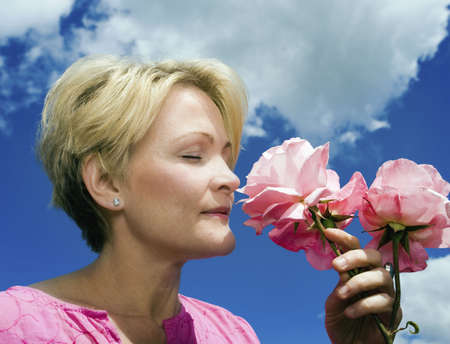 fulfilled: Women smelling roses