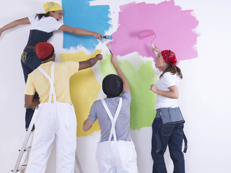 disagreed: Group of friends painting wall.