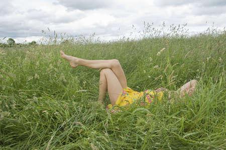 tetbury: Woman lying in field showing legs