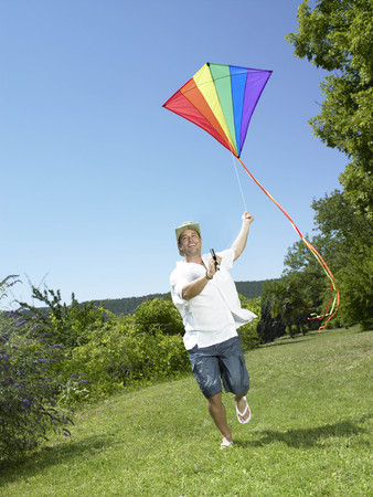 Man running with kite