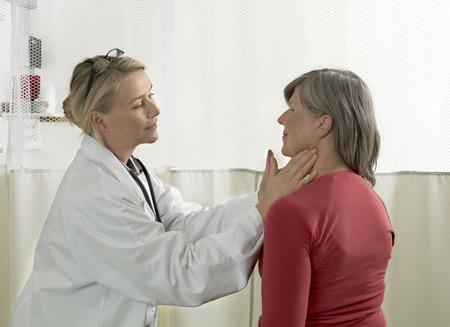 faiths: Doctor examining mature woman