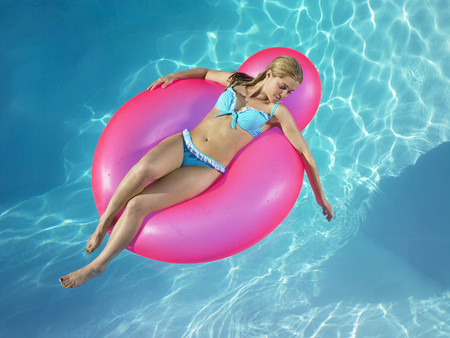 Girl in inflatable chair in pool