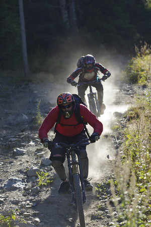 jeopardizing: Mountain bikers riding downhill