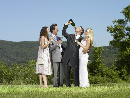 Wedding group drinking champagne