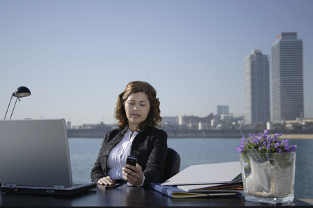 blue waters: Business woman in outdoor office