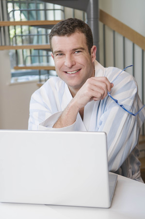 joyous: Portrait of a male at his laptop